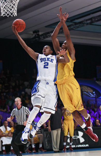 Duke guard Quinn Cook (2) drives to the basket as Minnesota forward Rodney Williams Jr. (33) defends during the first half of an NCAA college basketball game at the Battle 4 Atlantis tournament, Thursday, Nov. 22, 2012, in Paradise Island, Bahamas. (AP Photo/John Bazemore)