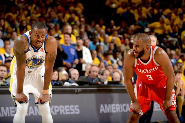 Both Andre Iguodala (left) and Chris Paul ended the 2018 Western Conference finals on the sidelines, dealing with leg injuries. (Getty)