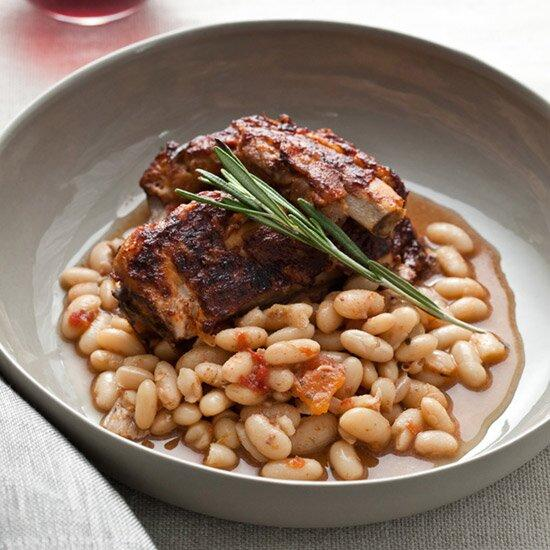 "<p>This warming eastern European short rib stew is best served in deep bowls over buttery noodles.</p><p><a href=""https://www.foodandwine.com/recipes/slow-cooker-glazed-pork-ribs-with-white-beans"">GO TO RECIPE</a></p>"