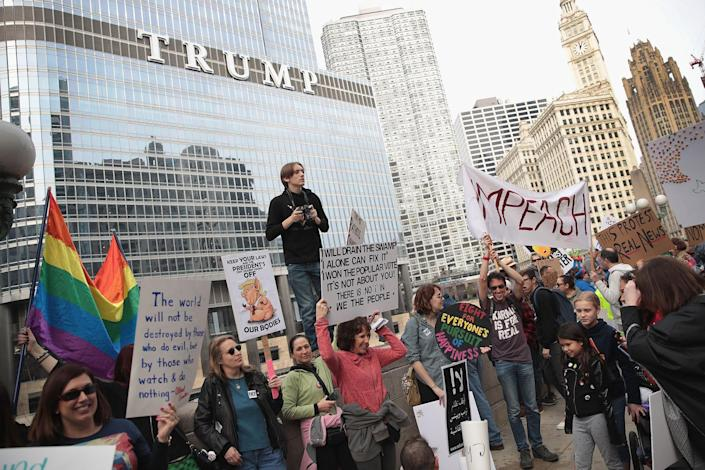 """<p>Demonstrators stage a Presidents' Day protest near Trump Tower on Feb. 20, 2017, in Chicago. The demonstration was one of many anti-Trump rallies held around the country on the federal holiday and billed as """"Not My President's Day."""" (Scott Olson/Getty Images) </p>"""