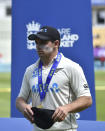 New Zealand captain Tom Latham waits to receive the winners trophy after their win in the second cricket test match against England at Edgbaston in Birmingham, England, Sunday, June 13, 2021. New Zealand won the series 1-0. (AP Photo/Rui Vieira)