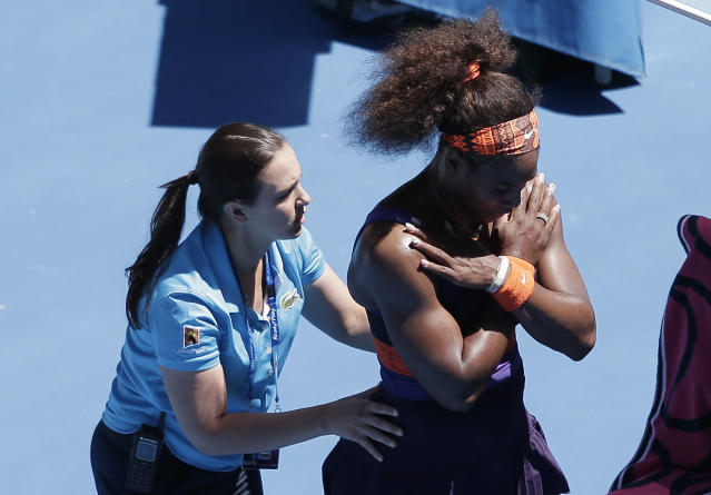 Serena Williams of the US receives treatment from a trainer during her quarterfinal match against compatriot Sloane Stephens at the Australian Open tennis championship in Melbourne, Australia, Wednesday, Jan. 23, 2013. (AP Photo/Rob Griffith)