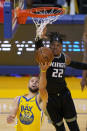 Golden State Warriors guard Stephen Curry (30) is blocked by Sacramento Kings center Richaun Holmes (22) during the first half of an NBA basketball game on Sunday, April 25, 2021, in San Francisco. (AP Photo/Tony Avelar)