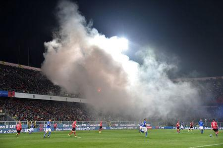 Football Soccer - Italy v Albania - World Cup 2018 Qualifiers - Group G - Renzo Barbera stadium, Palermo, Italy - 24/3/17. Smoke is seen as Albania's supporters light flares during the match. REUTERS/Alberto Lingria