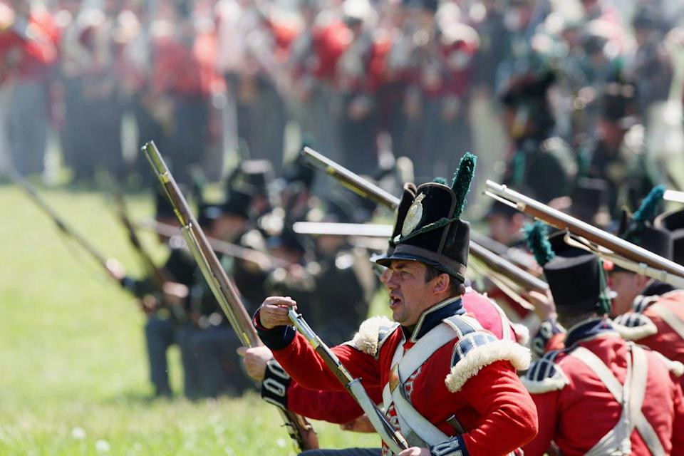 War of 1812 re-enactors stage a battle.