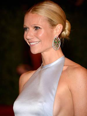 "<div class=""caption-credit""> Photo by: Getty Images</div><div class=""caption-title"">1. Sweet Bun</div>We don't know if its the sleekness, the sharp center part, or the few sexy escaped tendrils that make Gwyneth Paltrow's bun both festive and timeless-but it so is. Amp up the party quotient with a sparkly statement earring! <br> <b>Related: <a rel=""nofollow"" href=""http://www.cosmopolitan.com/sex-love/relationship-advice/relationship-advice-for-women?link=rel&dom=yah_life&src=syn&con=blog_cosmo&mag=cos"" target=""_blank"">Relationship Advice From Men</a> <br> Related: <a rel=""nofollow"" href=""http://www.cosmopolitan.com/advice/health/what-to-eat-before-a-workout?link=rel&dom=yah_life&src=syn&con=blog_cosmo&mag=cos"" target=""_blank"">Eat This Before You Work Out</a> <br> Related: <a rel=""nofollow"" href=""http://www.cosmopolitan.com/advice/work-money/ways-to-save-money?link=rel&dom=yah_life&src=syn&con=blog_cosmo&mag=cos"" target=""_blank"">How to Save Money And Still Have a Life</a></b> <br>"