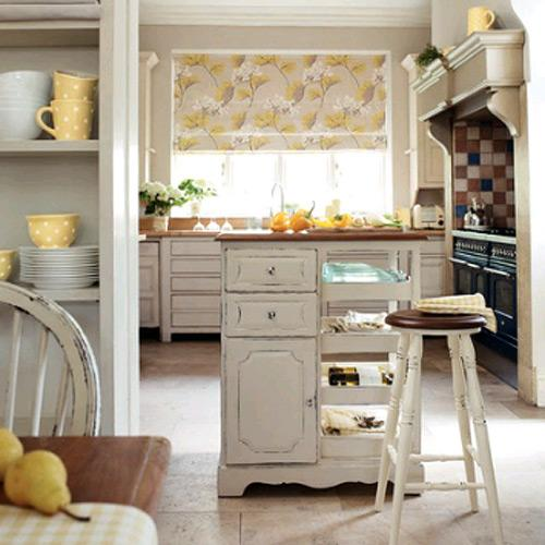 """<b>Country credentials</b><br><br>For a fresh country look, team distressed cream units with wooden worktops and pretty accessories. The units, blind and accessories shown are all available from Laura Ashley.<br><br>If a new kitchen is beyond the budget, a free-standing <a href=""""http://mto.lauraashley.com/furniture/cabinet/3375946/confirmation/bramley-armoire"""" rel=""""nofollow noopener"""" target=""""_blank"""" data-ylk=""""slk:Bramley Armoire"""" class=""""link rapid-noclick-resp"""">Bramley Armoire</a> £630 from the same range, is a great way to get the look. Simply add pretty crockery and folded linens for instant country credentials."""