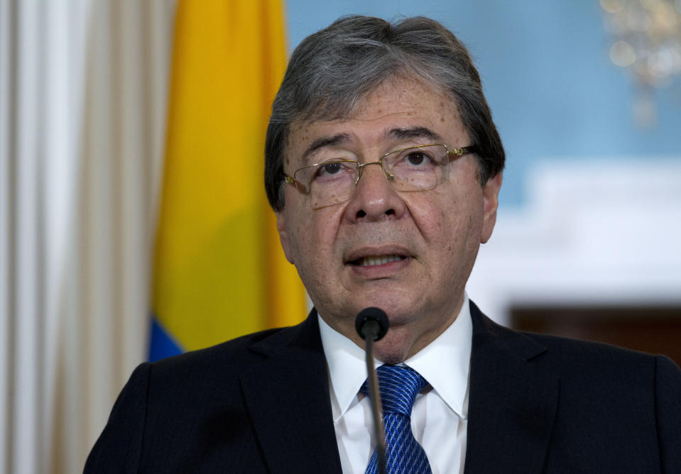 """FILE - In this Oct. 9, 2019 file photo, Colombian Foreign Minister Carlos Holmes Trujillo speaks to reporters after a bilateral meeting at the Department of State in Washington. Colombian officials say Defense Minister Carlos Holmes Trujillo has died from complications of COVID-19. He was 69. President Ivan Duque said in a statement that Holmes Trujillo died early Tuesday, Jan. 26, 2021 adding that he """"couldn't express the pain"""" he was feeling over the news. (AP Photo/Jose Luis Magana, file)"""