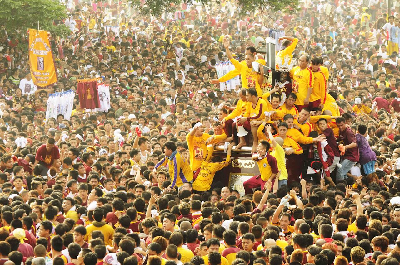 Seen at the annual Feast of the Black Nazarene during the procession from Quirino Grandstand, Metro Manila back to the Quiapo church on 09 January 2012. (Angela Galia/NPPA images)