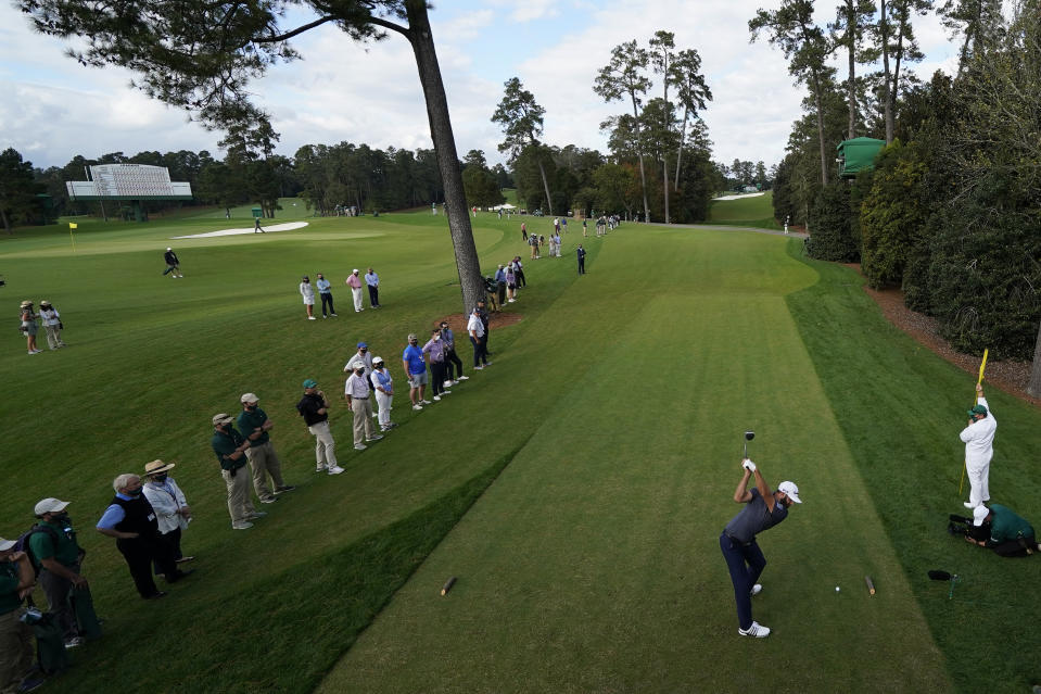 Dustin Johnson tees off on the 18th hole of the Masters last year. The 18th hole is where the Masters' sudden-death playoff begins. (AP Photo/David J. Phillip)