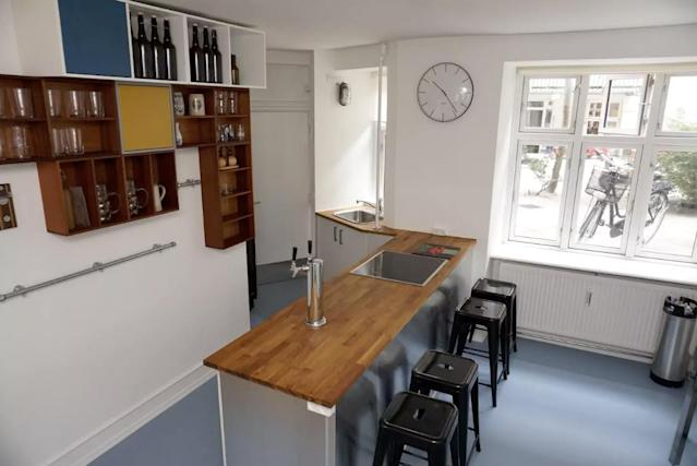 <p>If you're looking for a more urban beer vacation, this B&B (Bed and Beer) in Copenhagen, Denmark that costs $176 a night could be right for you. The fully stocked kitchen and bar counter are seen here. (Airbnb) </p>
