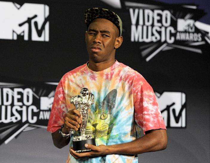FILE - This Aug. 28, 2011 file photo shows Tyler the Creator posing backstage with the award for best new artist backstage at the MTV Video Music Awards in Los Angeles. PepsiCo said it immediately pulled the 60-second Mountain Dew ad after learning that people found it was offensive. The ad was part of a series developed by African-American rapper Tyler, The Creator, and depicted a battered white woman on crutches being urged to identify a suspect out of a lineup of black men.(AP Photo/Chris Pizzello, file)