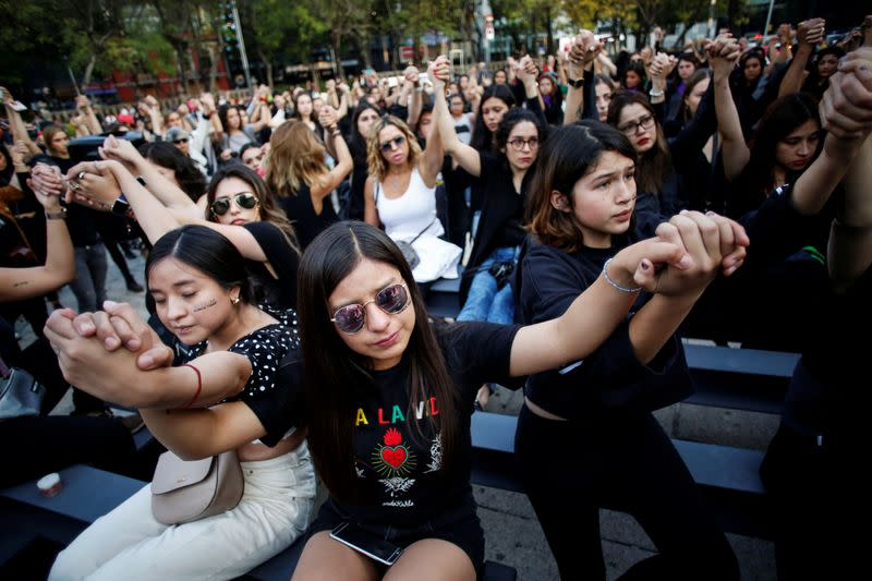 FILE PHOTO: Women protest against gender violence and femicides at Angel de la Independencia monument in Mexico City