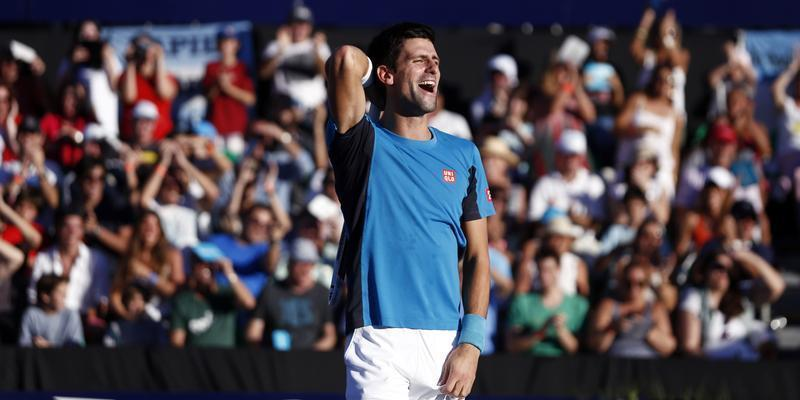 Serbia's Djokovic laughs during his exhibition doubles tennis match with Spain's Nadal against Argentina's Nalbandian and compatriot Monaco in Buenos Aires