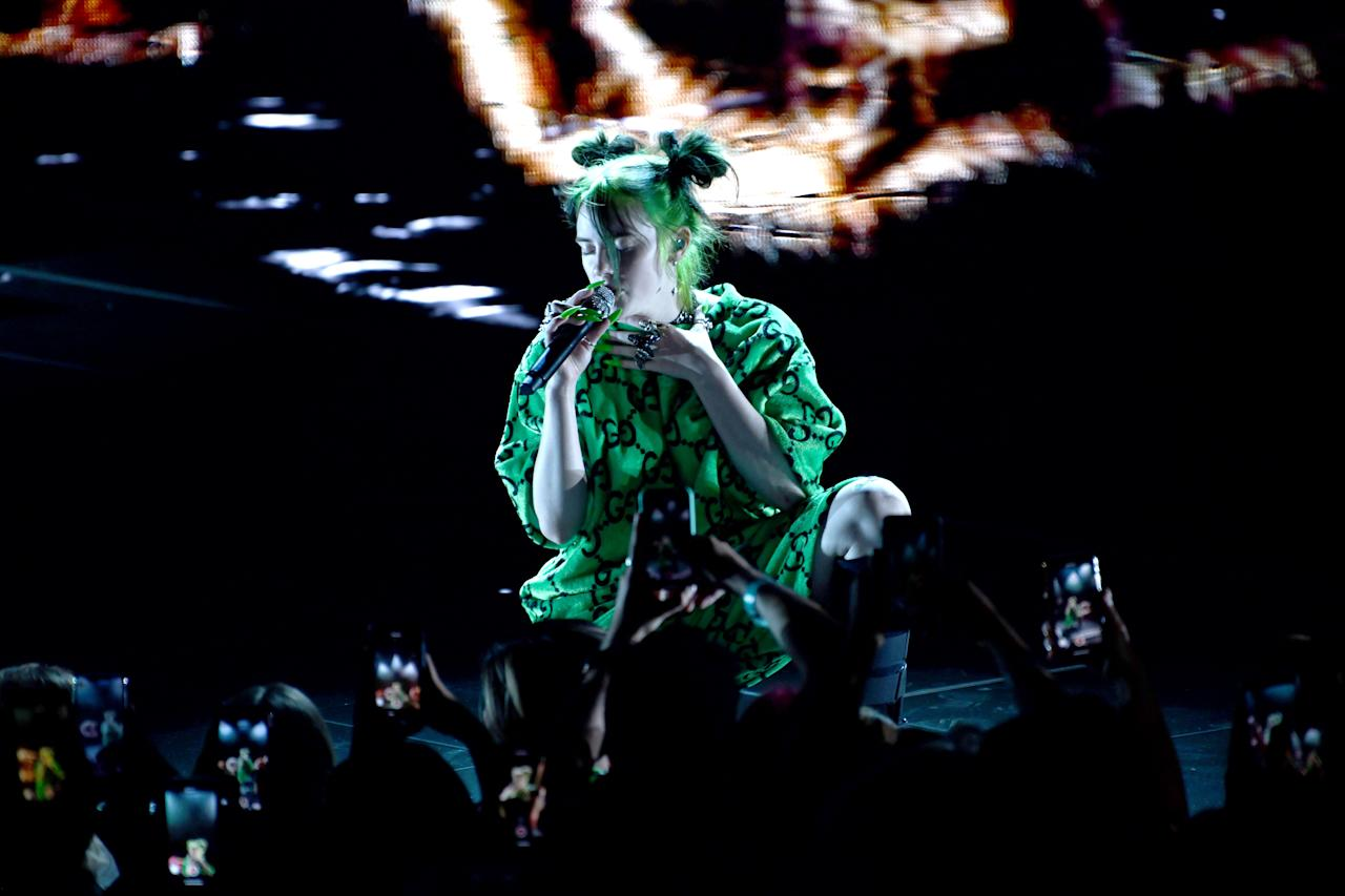 This all neon green everything look included Billie's hair, too.