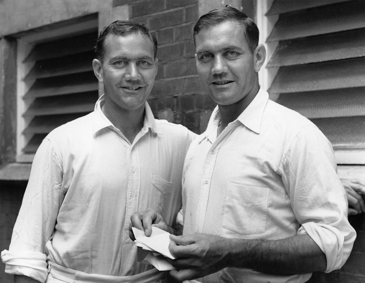 English test cricketer Alec Bedser, right, and his brother Eric, also a cricket player.  Original Publication: People Disc - HA0260   (Photo by Central Press/Getty Images)