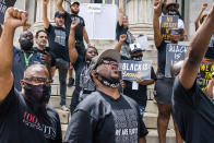 Terrence Floyd, center, the brother of George Floyd, attends a rally on Sunday, May 23, 2021, in Brooklyn borough of New York. George Floyd, whose May 25, 2020 death in Minneapolis was captured on video, plead for air as he was pinned under the knee of former officer Derek Chauvin, who was convicted of murder and manslaughter in April 2021. (AP Photo/Eduardo Munoz Alvarez)
