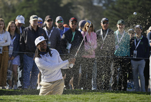 Larry Fitzgerald follows his shot out of a bunker onto the second green of the Pebble Beach Golf Links at last weekend's pro-am. (AP)