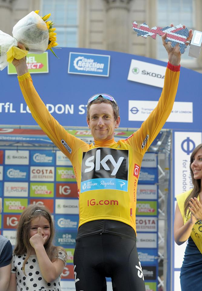 Team Sky's Sir Bradley Wiggins celebrates winning the Gold Jersey following stage eight of the 2013 Tour of Britain in London.