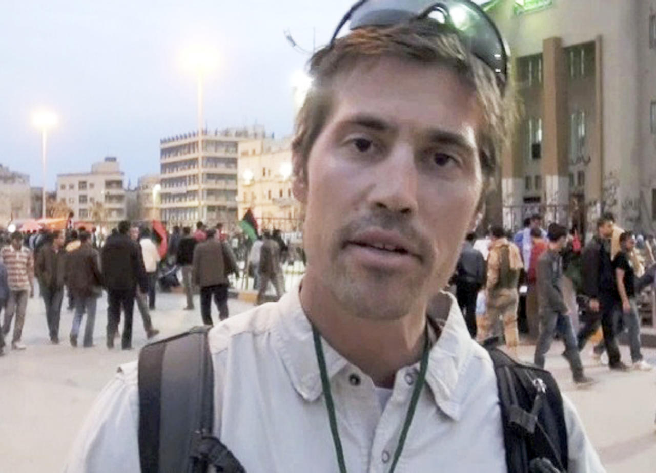 FILE - This undated file still image from video released April 7, 2011, by GlobalPost, shows James Foley of Rochester, N.H., a freelance contributor for GlobalPost, in Benghazi, Libya. A Libyan government spokesman says four journalists detained since early April have completed an administrative hearing and will be released Tuesday or Wednesday.