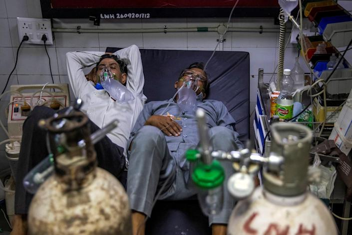 Patients suffering from COVID-19 receive treatment in the casualty ward of a New Delhi hospital on April 15, 2021.