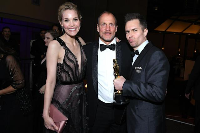 <p>Best Supporting Actor winner Rockwell celebrated with his Three Billboards Outside Epping, Missouri costar, his longtime girlfriend, and a little guy named Oscar at the Governors Ball. (Photo: Angela Weiss/AFP/Getty Images) </p>