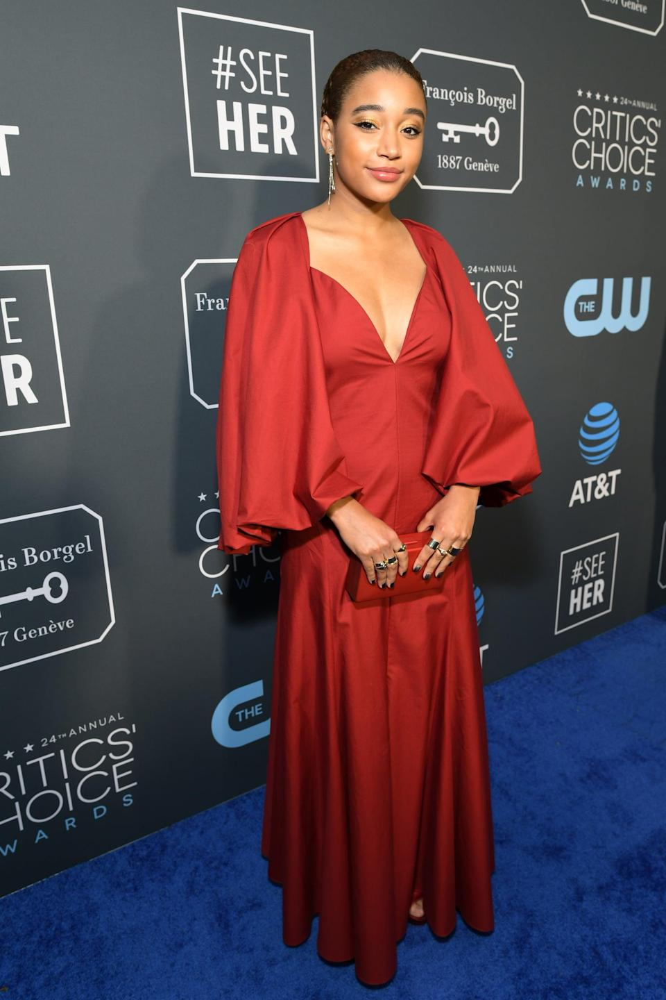 <p>Amandla Stenberg wearing a Khaite gown with jewels by Graziela Gems, Jennifer Fisher, and Anita Ko. She finished her look off with Jimmy Choo heels.</p>