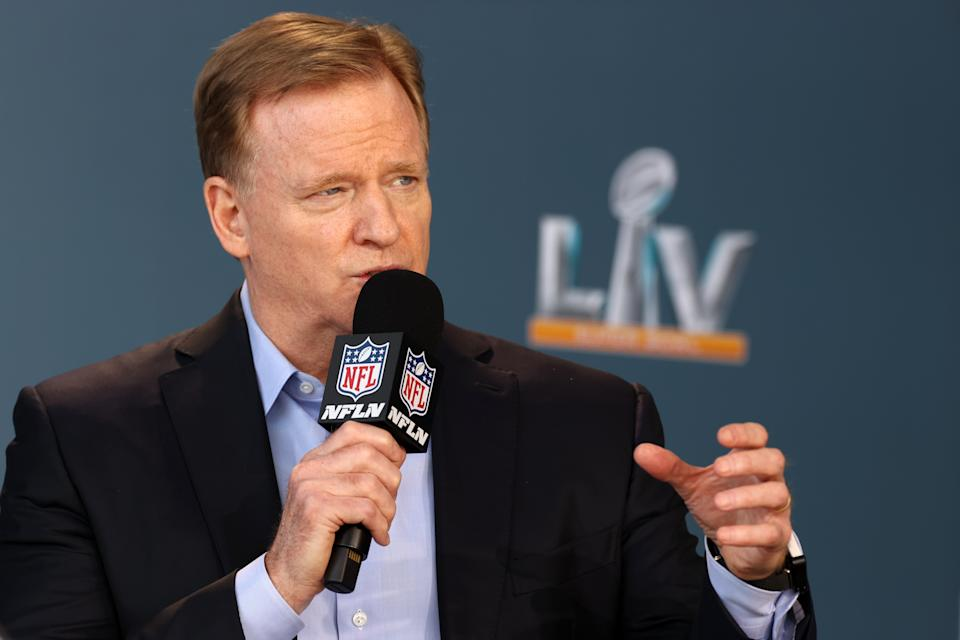 Roger Goodell with a microphone.