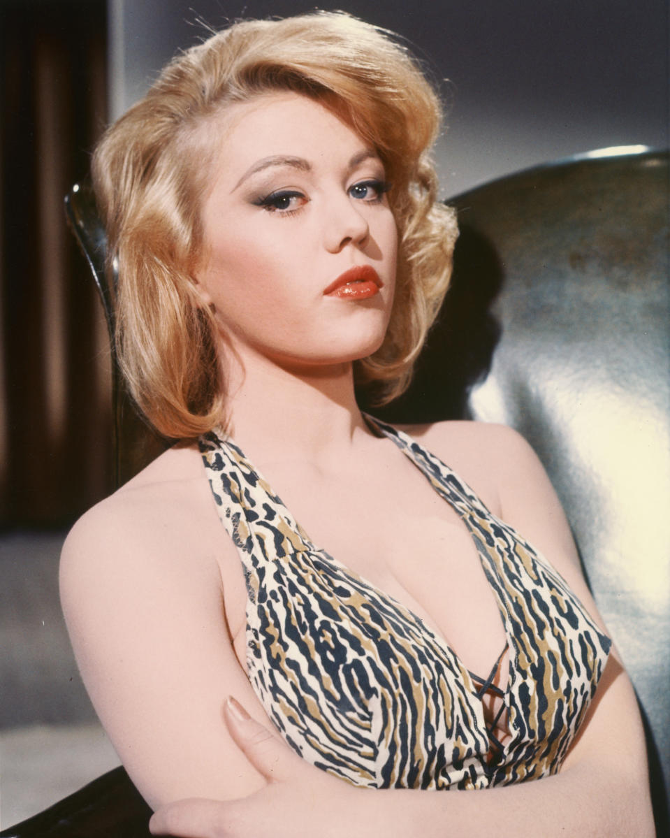 Margaret Nolan, British actress and glamour model, wearing a tiger print halterneck top, with her arms crossed, circa 1965. (Photo by Silver Screen Collection/Getty Images)