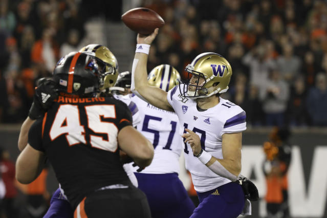 Washington quarterback Jacob Eason (10) throws a pass during the first half of the team's NCAA college football game against Oregon State in Corvallis, Ore., Friday, Nov. 8, 2019. (AP Photo/Amanda Loman)