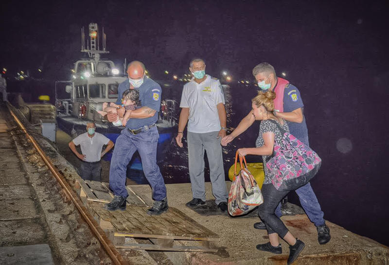 In this image provided by the Romanian border police, migrants are assisted by border policemen in the Black Sea port of Constanta, Romania, early Wednesday, Sept. 13, 2017. Romania's coast guard has rescued before dawn more than 150 migrants from Iraq and Iran, of which 53 children, from a ship in distress on the Black Sea, on what is becoming a new route for migrants trying to reach Western Europe.(Politia de Frontiera Romana via AP) ROMANIA OUT