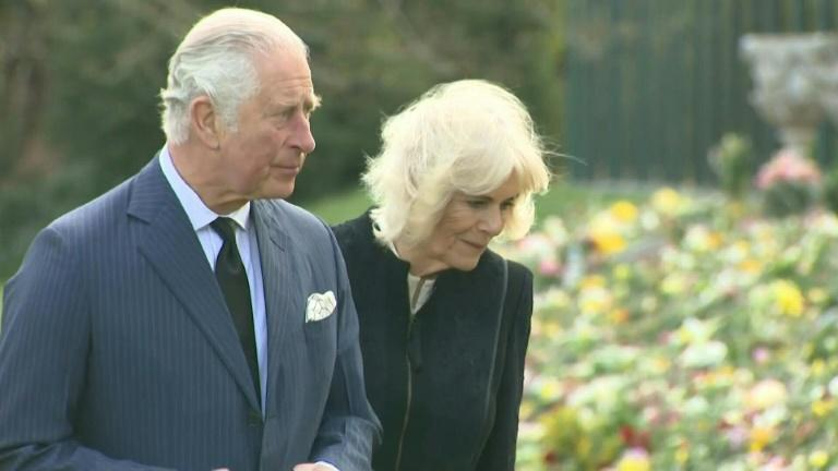 Prince Charles and Camilla look at tributes to Prince Philip