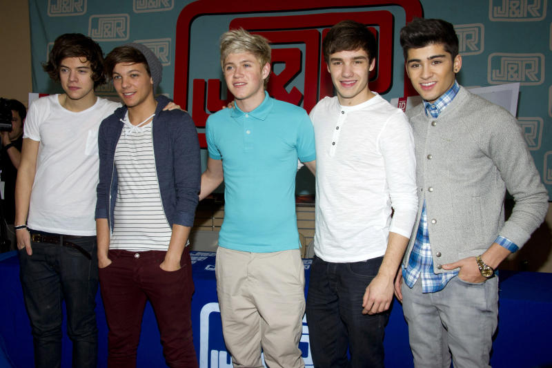 "FILE- In this March 12, 2012 file photo, One Direction band members from left, Harry Styles, Louis Tomlinson, Niall Horan, Liam Payne and Zayn Malik pose during a CD signing for their debut album ""Up All Night,"" at J&R Music World in New York. Malik said Wednesday, March 25, 2015, he is leaving chart-topping boy band One Direction ""to be a normal 22-year-old."" His bandmates said they were sad to see him go ""but we totally respect his decision and send him all our love for the future."" (AP Photo/Charles Sykes, File)"