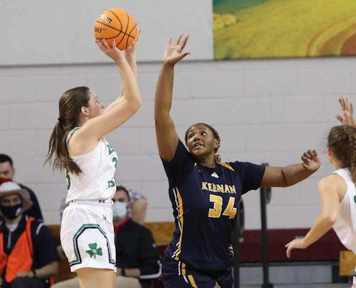 Bishop England's Ella Schar (33) shoots as Keenan's Samaya Johnson blocksduring the 3A state championship game at the USC Aiken Convocation Center on Friday, March 5, 2021.