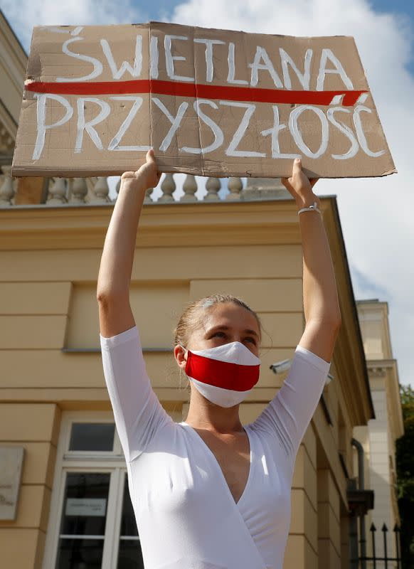 FILE PHOTO: People carrying historical white-red-white flags of Belarus gather in Warsaw