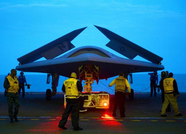ATLANTIC OCEAN - MAY 13: In this handout released by the U.S. Navy, an X-47B Unmanned Combat Air System (UCAS) demonstrator is towed into the hangar bay of the aircraft carrier USS George H.W. Bush (CVN 77) May 13, 2013 in the Atlantic Ocean. George H.W. Bush is scheduled to be the first aircraft carrier to catapult-launch an unmanned aircraft from its flight deck. The Navy plans to have unmanned aircraft on each of its carriers to be used for surveillance and be armed and used in combat roles. (Photo by Mass Communication Specialist 2nd Class Timothy Walter/U.S. Navy via Getty Images)