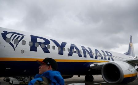 Passengers wait to board a Ryanair flight at Gatwick Airport in London