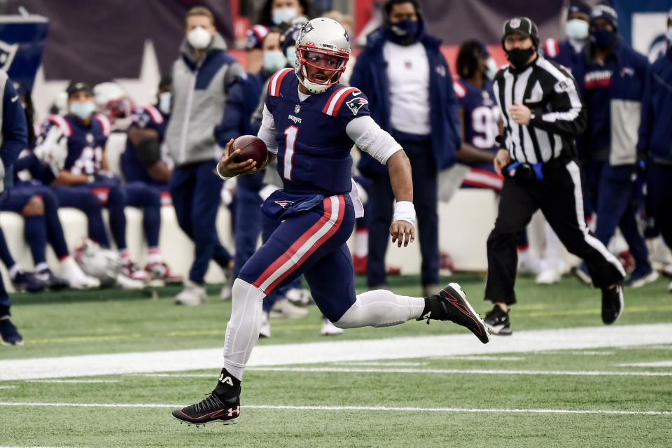 FOXBOROUGH, MA - JANUARY 03: Cam Newton #1 of the New England Patriots carries the ball during the first quarter of a game against the New York Jets at Gillette Stadium on January 3, 2021 in Foxborough, Massachusetts. (Photo by Billie Weiss/Getty Images)