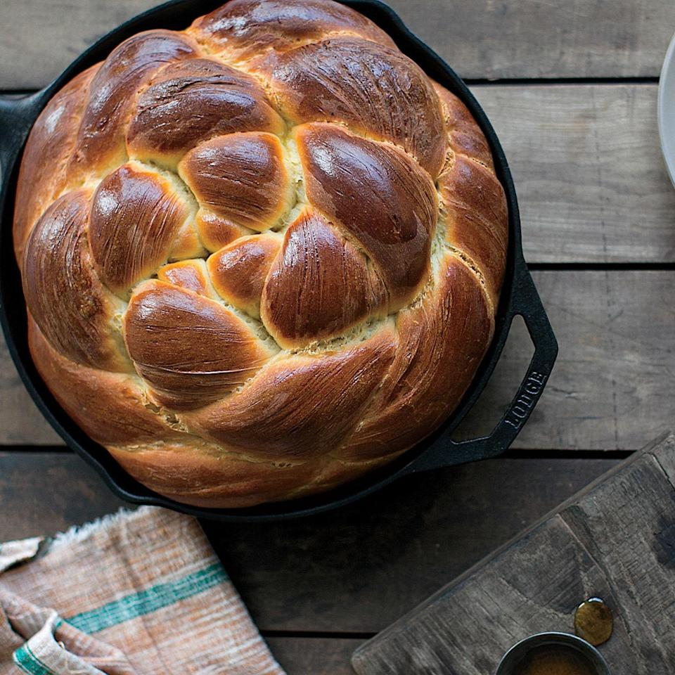 "Baked in cast-iron skillets, these loaves are dense, soft, and subtly sweet. <a href=""https://www.epicurious.com/recipes/food/views/challah-bread-51256510?mbid=synd_yahoo_rss"" rel=""nofollow noopener"" target=""_blank"" data-ylk=""slk:See recipe."" class=""link rapid-noclick-resp"">See recipe.</a>"