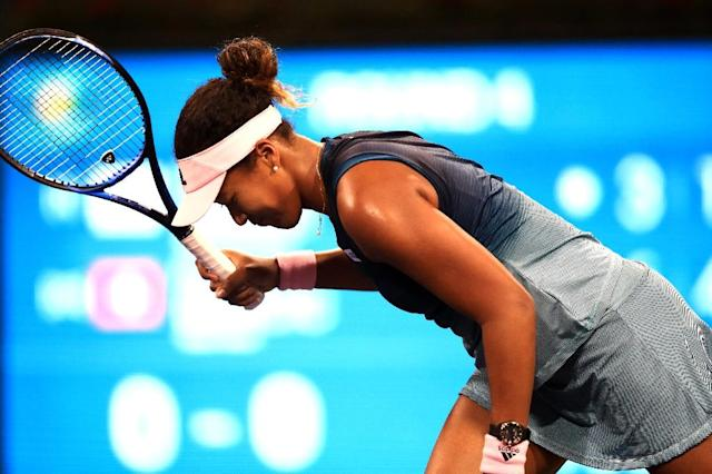 Japan's world number one Naomi Osaka's Indian Wells WTA title defense ends with a fourth-round loss to Switzerland's Belinda Bencic (AFP Photo/Sean M. Haffey)