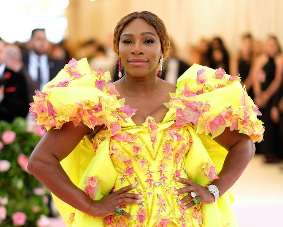 Williams in a flashy yellow and pink dress