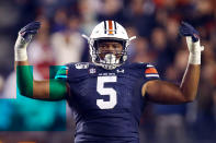 FILE - In this Nov. 16, 2019, file photo, Auburn defensive tackle Derrick Brown (5) reacts after a stop against Georgia during the second half of an NCAA college football game, in Auburn, Ala. Brown was selected the SEC defensive player of the year on The Associated Press All-Southeastern Conference football team, Monday, Dec. 9, 2019. (AP Photo/Butch Dill, File)