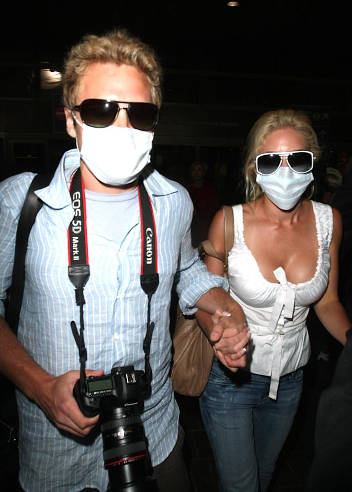 """<div class=""""caption-credit""""> Photo by: Getty Images</div><div class=""""caption-title""""></div>In the event of decompression, Heidi and Spencer Pratt don't need oxygen masks. They wore their own while parading through Los Angeles International Airport in April 2009. Sigh. <br>"""