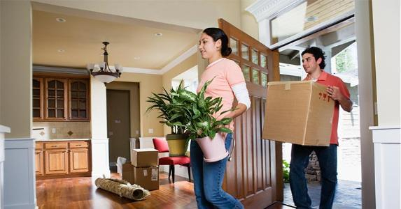 Young couple moving into their new home | ColorBlind/Getty Images