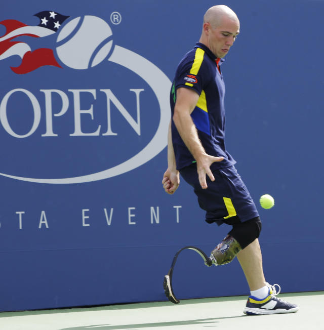 Ball person Ryan McIntosh of San Antonio, Texas chases down a ball during the match between Lukas Lacko and James Blake in the first round of play at the 2012 U.S. Open tennis tournament, Monday, Aug. 27, 2012, in New York. (AP Photo/Kathy Willens)