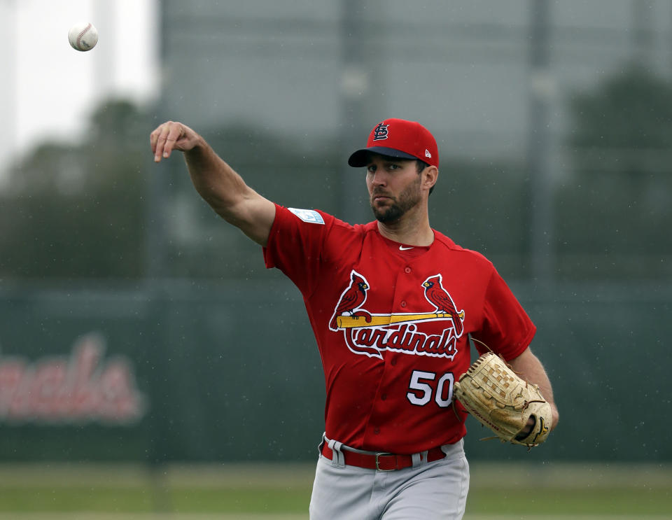 Cardinals pitcher Adam Wainwright expresses worry that the players could walkout during the season if issues with the owners aren't fixed. (AP)