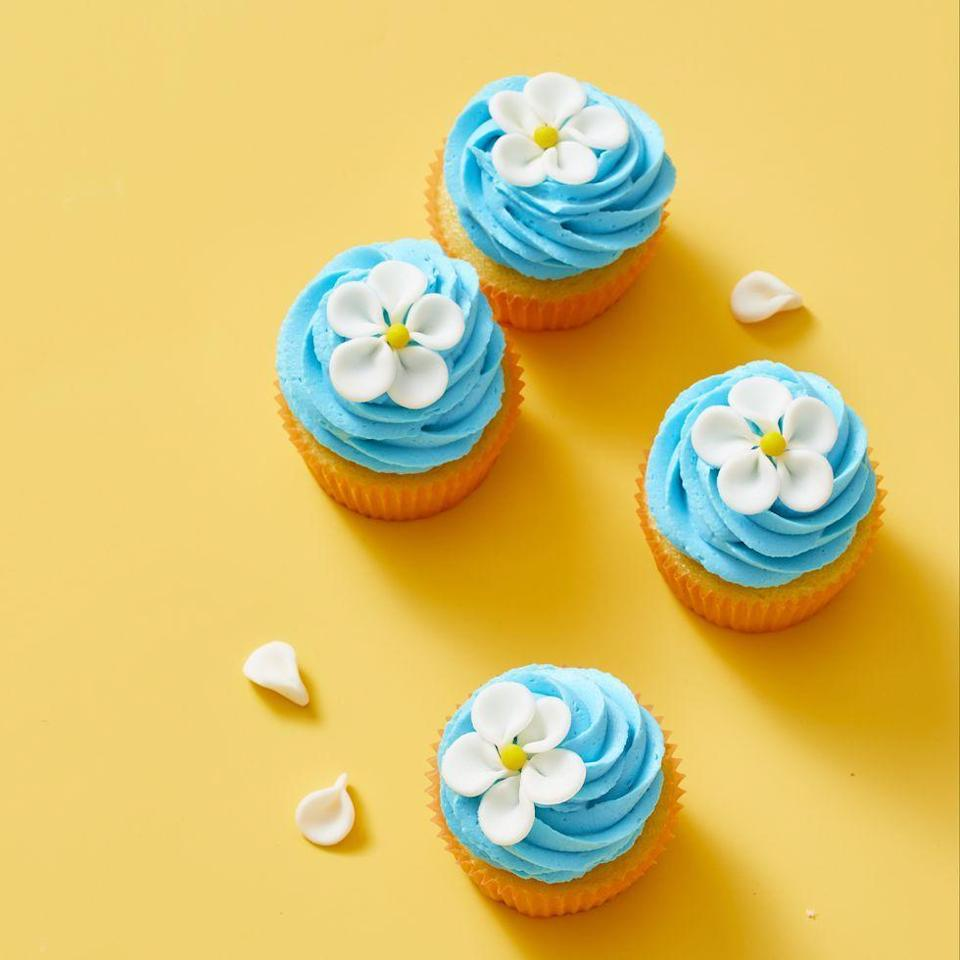 """<p>Add these dainty spring cupcakes, made with fondant, to your Easter centerpiece. </p><p><em><a href=""""https://www.goodhousekeeping.com/food-recipes/dessert/a30809974/flower-cupcake-recipe/"""" rel=""""nofollow noopener"""" target=""""_blank"""" data-ylk=""""slk:Get the recipe for Flower Cupcakes »"""" class=""""link rapid-noclick-resp"""">Get the recipe for Flower Cupcakes »</a></em></p><p><strong>RELATED: </strong><a href=""""https://www.goodhousekeeping.com/holidays/easter-ideas/g2217/easter-decorations/"""" rel=""""nofollow noopener"""" target=""""_blank"""" data-ylk=""""slk:50+ DIY Easter Decoration Ideas That Bring All the Spring Cheer"""" class=""""link rapid-noclick-resp"""">50+ DIY Easter Decoration Ideas That Bring All the Spring Cheer</a><br></p>"""