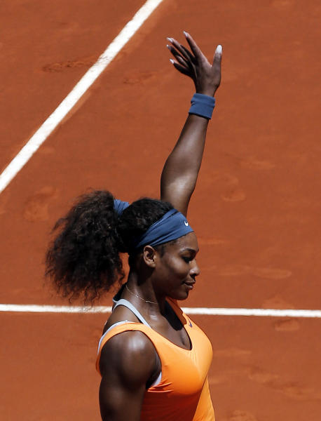 Serena Williams from U.S. celebrates her victory during the match against Maria Kirilenko from Russia at the Madrid Open tennis tournament, in Madrid, Thursday, May 9, 2013. (AP Photo/Andres Kudacki)