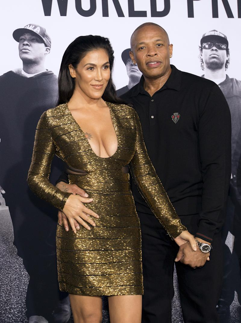 """Producer Dr. Dre and his wife Nicole Young pose at the premiere of """"Straight Outta Compton"""" in Los Angeles, California August 10, 2015. The movie opens in the U.S. on August 14. REUTERS/Mario Anzuoni"""