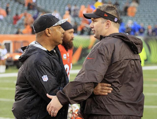 Cincinnati Bengals head coach Marvin Lewis, left, meets with Cleveland Browns head coach Rob Chudzinski after the Bengals defeated the Browns 41-20 in an NFL football game, Sunday, Nov. 17, 2013, in Cincinnati. (AP Photo/Tom Uhlman)